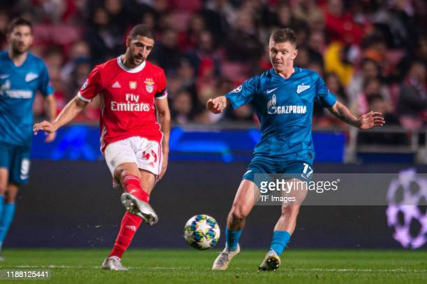 Adel Taarabt of SL Benfica and oleg Shatov of Zenit St Petersburg battle for the ball during the UEFA Champions League group G match between SL...