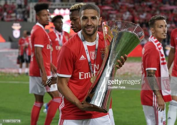 Adel Taarabt of SL Benfica celebrates with trophy after winning the Portuguese SuperCup at the end of the Portuguese SuperCup match between SL...