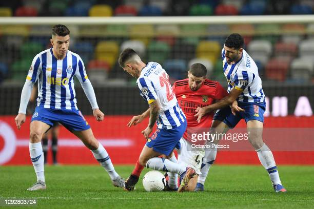 Adel Taarabt of SL Benfica is tackled by Otavio and Mehdi Taremi of FC Porto during the Portuguese Super Cup final between FC Porto and SL Benfica at...