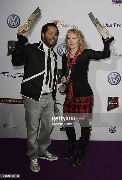 Adel Tawil and Annette Humpe pose with their awards during the Echo award 2011 at Palais am Funkturm on March 24 2011 in Berlin Germany