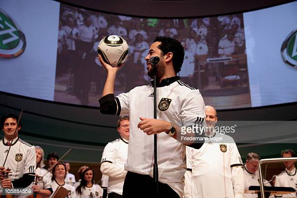 Adel Tawil and Essener Philharmoniker perform during the DFB Bundestag at the Philharmonie on October 21 2010 in Essen Germany