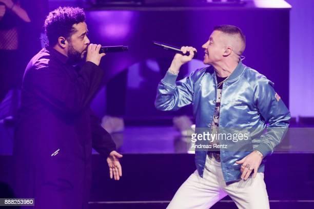 Adel Tawil and Macklemore aka Benjamin Hammond Haggerty perform on stage during the 1Live Krone radio award at Jahrhunderthalle on December 07 2017...