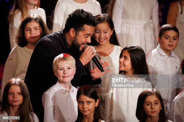 Adel Tawil and the children's choir 'Blue Voice' perform at the Ein Herz Fuer Kinder Gala show at Studio Berlin Adlershof on December 9 2017 in...