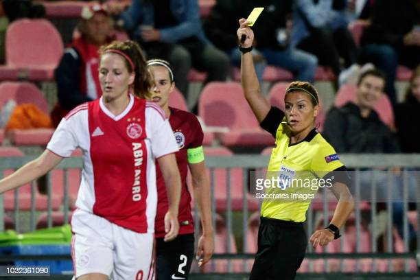 Adela Odehnalova of Sparta Praha Women receives a yellow card from referee Meliz Ozcigdem during the UEFA Champions League Women match between Ajax v...