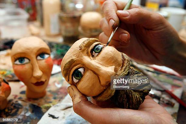 Adela Souckova paints a face on a marionette in the Truhlar Marionety puppet workshop in Prague Czech Republic on Wednesday July 9 2008 The Czech...