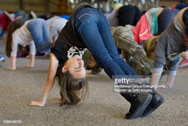 Adela Tirla a firstgrader at Stonegate Elementary School in irvine goes through exercises in her yoga class The school got 66 percent on its fitness...
