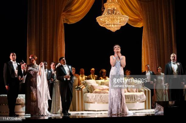 Adela Zaharia center performs as Violetta in Los Angeles Opera's production of Verdi's La Traviata at the Dorothy Chandler Pavilion in Los Angeles on...