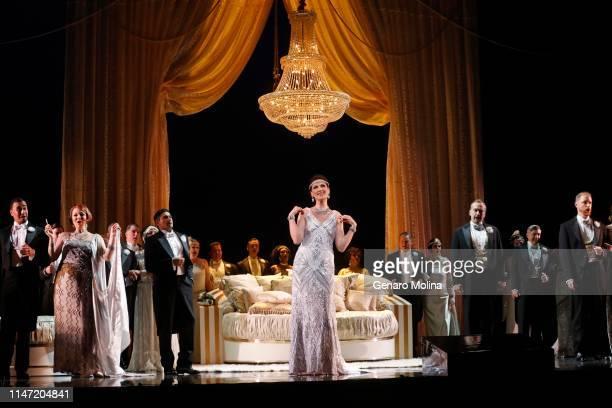 "Adela Zaharia, center, performs as Violetta in Los Angeles Opera's production of Verdi's ""La Traviata,"" at the Dorothy Chandler Pavilion in Los..."