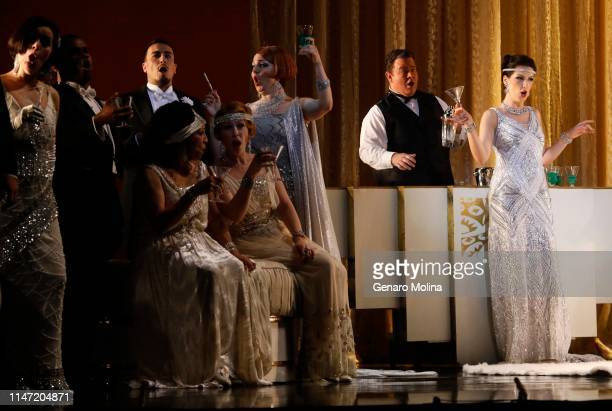 """Adela Zaharia, right, performs as Violetta in Los Angeles Opera's production of Verdi's """"La Traviata,"""" at the Dorothy Chandler Pavilion in Los..."""