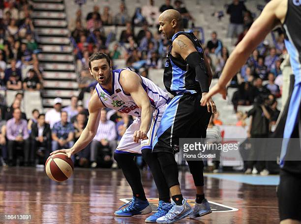 Adelaide 36ers Adam Gibson is defended by New Zealand Breakers point guard CJ Bruton during the round four NBL match between the New Zealand Breakers...
