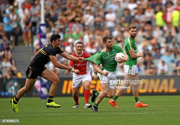 Adelaide Australia 12 November 2017 Chris Barrett of Ireland is tackled by Scott Pendlebury of Australia during the Virgin Australia International...
