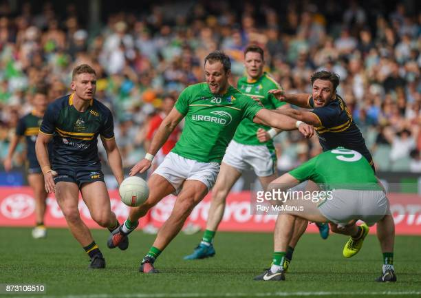 Adelaide , Australia - 12 November 2017; Paul Geaney of Ireland ducks as his team mate Michael Murphy fires in a shot under pressure from Michael...