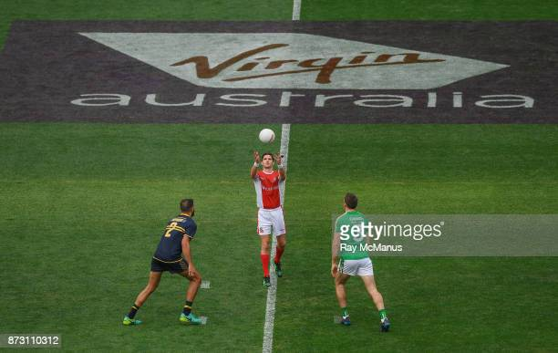 Adelaide Australia 12 November 2017 Referee Matt Stevic throws in the ball between Paddy Ryder of Australia and Gary Brennan of Ireland during the...