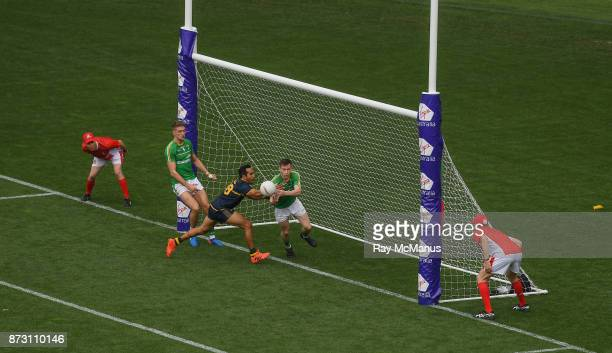Adelaide Australia 12 November 2017 The Umpires look on as Karl O'Connell of Ireland supported by Killian Clarke clears the ball on the line from...