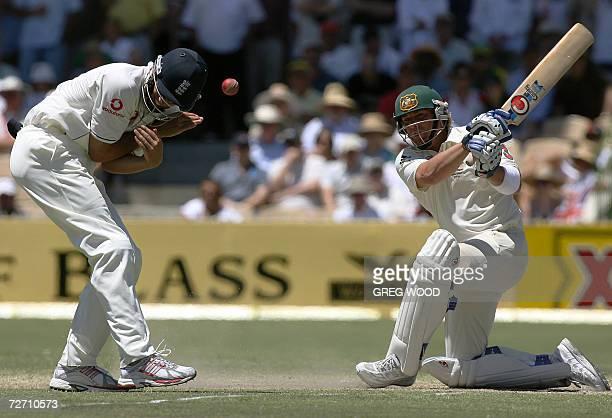Australian batsman Shane Warne pulls the ball as closein England fieldsman Alastair Cook takes evasive action on dayfour of the second Ashes cricket...