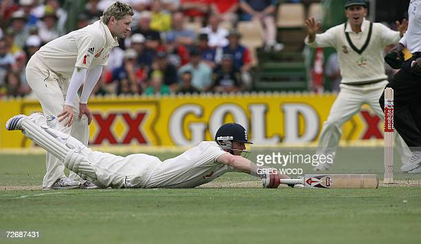 England's Paul Collingwood dives to make his ground during day one of the second Ashes cricket Test against Australia at the Adelaide Oval, 01...