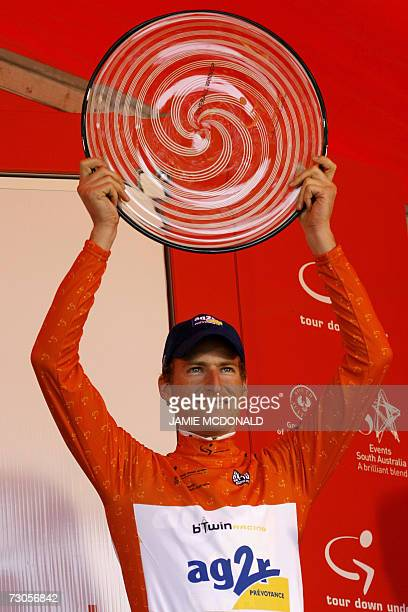 Martin Elmiger from Switzerland representing the French Ag2R team holds the trophy after winning the Tour Down Under cycling race in Adelaide 21...