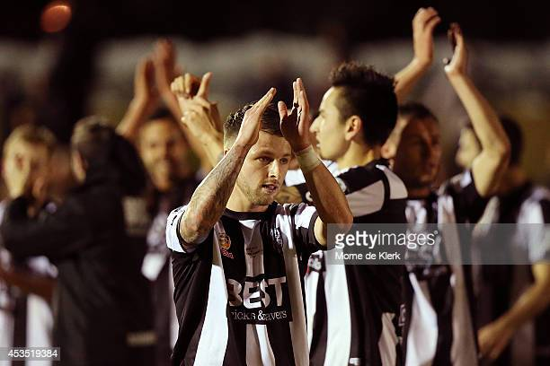 Adelaide City players celebrate after winning the FFA Cup match between Adelaide City and Western Sydney Wanderers at Marden Sports Complex on August...