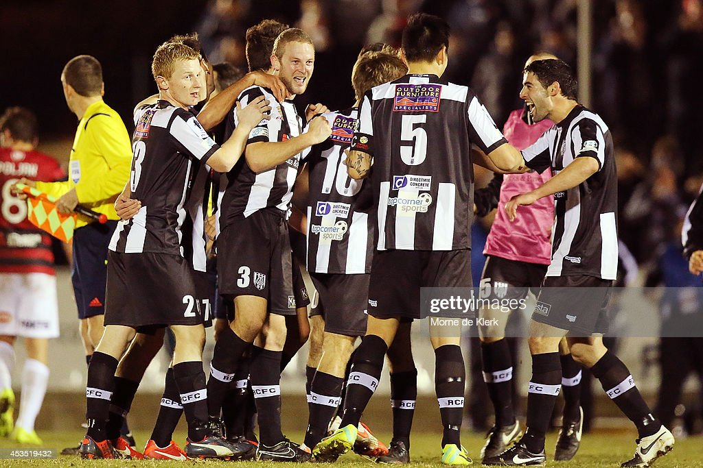 Adelaide City players celebrate after winning the the FFA Cup match between Adelaide City and Western Sydney Wanderers at Marden Sports Complex on August 12, 2014 in Adelaide, Australia.
