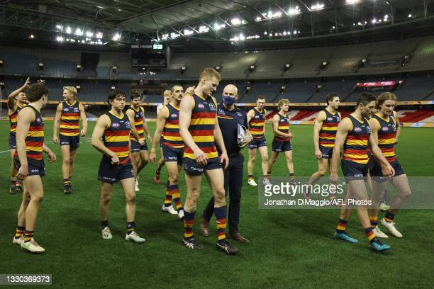 Adelaide Coach Matthew Nicks walks off with his team after their victory during the round 20 AFL match between Adelaide Crows and Hawthorn Hawks at...