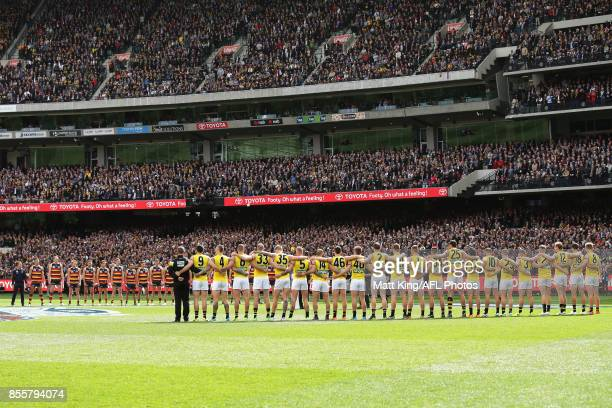 Adelaide Crows and Richmond Tigers line up for the national anthem during the 2017 AFL Grand Final match between the Adelaide Crows and the Richmond...