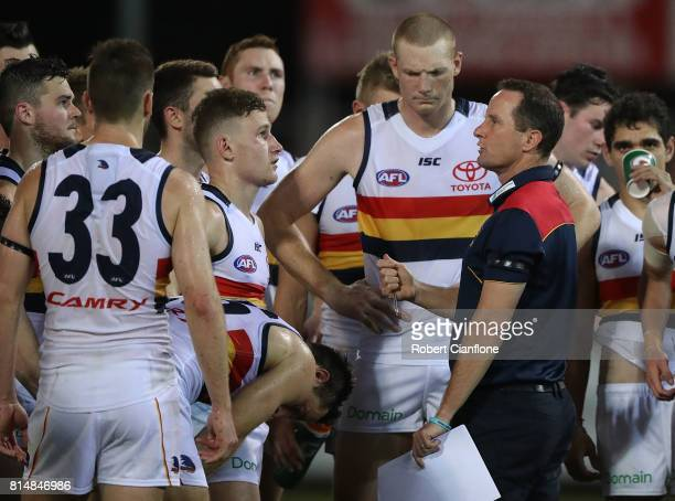 Adelaide Crows coach Don Pyke speaks to his players at the break during the round 17 AFL match between the Melbourne Demons and the Adelaide Crows at...
