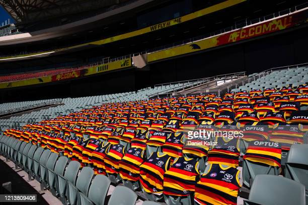 Adelaide Crows guernsey'shoots are pictured where their cheer squad would sit prior to round 1 AFL match between the Adelaide Crows and the Sydney...