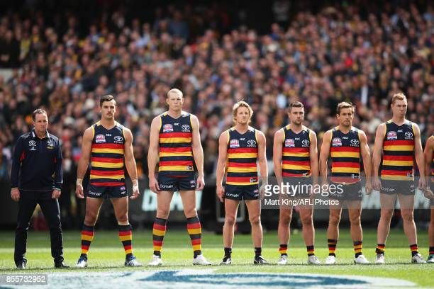 Adelaide Crows line up for the national anthem during the 2017 AFL Grand Final match between the Adelaide Crows and the Richmond Tigers at Melbourne...