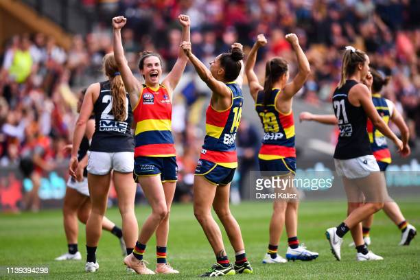Adelaide Crows players celebrate as the final siren sounds during the AFLW Grand Final match between the Adelaide Crows and the Carlton Blues at...