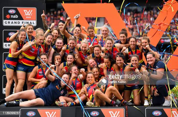 Adelaide Crows players celebrate with the AFLW Premiership Cup during the AFLW Grand Final match between the Adelaide Crows and the Carlton Blues at...