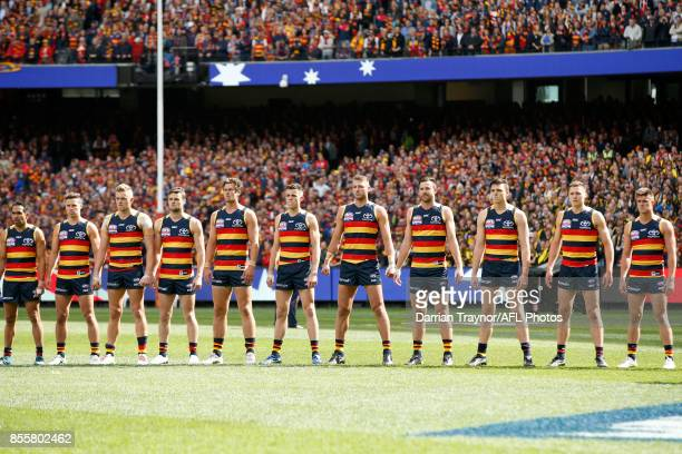 Adelaide Crows players line up for the national anthem before the 2017 AFL Grand Final match between the Adelaide Crows and the Richmond Tigers at...