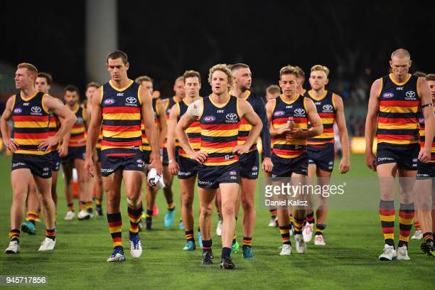 Adelaide Crows players walk from the field looking dejected after the round four AFL match between the Adelaide Crows and the Collingwood Magpies at...