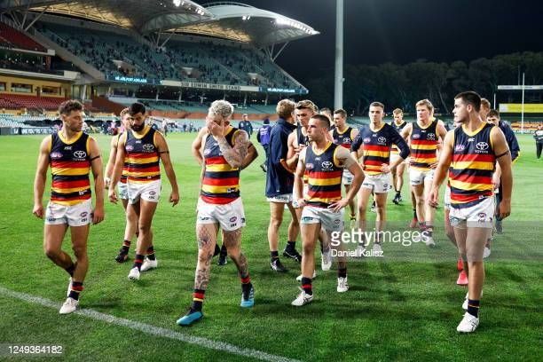 Adelaide Crows players walk from the ground during the round 2 AFL match between the Port Adelaide Power and the Adelaide Crows at Adelaide Oval on...