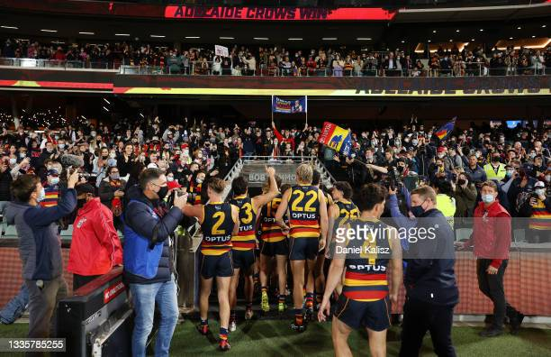Adelaide Crows players walk from the ground during the round 23 AFL match between Adelaide Crows and North Melbourne Kangaroos at Adelaide Oval on...