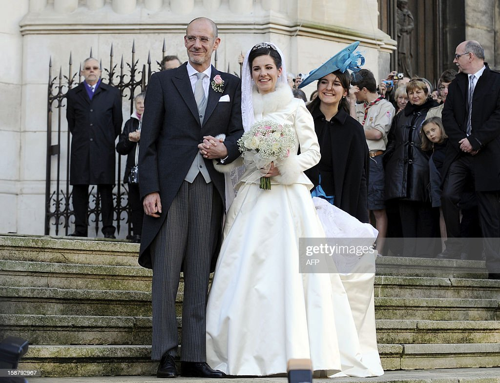 Adelaide Drape-Frisch (C) poses with her father Philippe Drape-Frisch (L) and her sister Alienor Drape-Frisch in front of the Saint Epvre Basilica before her wedding with Archduke of Austria Christoph of Habsbourg, on December 29, 2012 in Nancy.