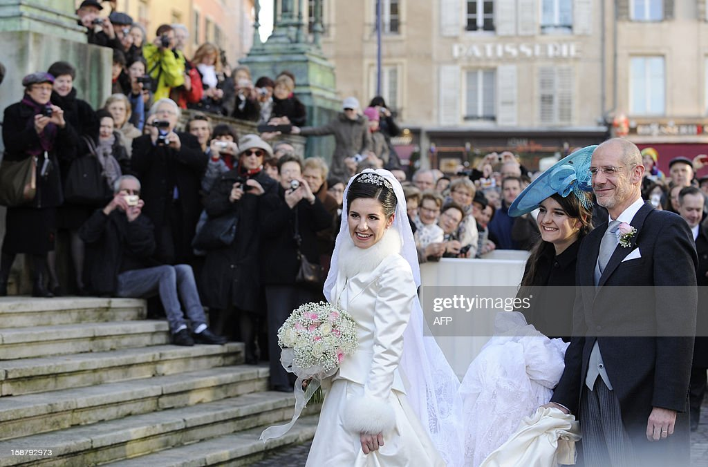 Adelaide Drape-Frisch (L) poses with her father Philippe Drape-Frisch (R) and her sister Alienor Drape-Frisch in front of the Saint Epvre Basilica before her wedding with Archduke of Austria Christoph of Habsbourg, on December 29, 2012 in Nancy.