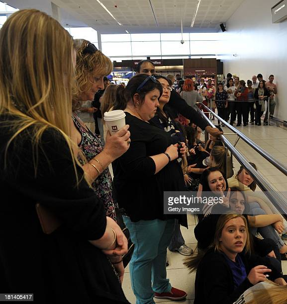 Adelaide fans of One Direction wait patiently at Adelaide Airport for their idols to arrive on September 21 2013 in Adelaide Australia