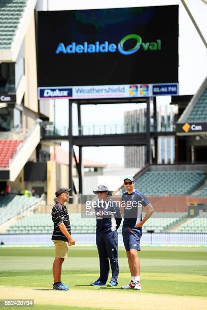 Adelaide Oval curator Damian Hough chats with England Head Coach Trevor Bayliss and Alastair Cook of England as they inspect the pitch prior to an...