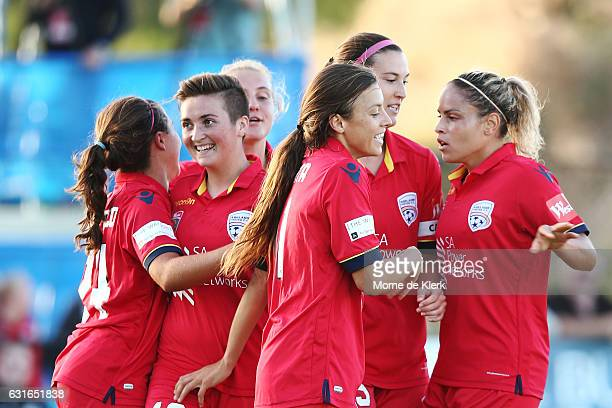 Adelaide players celebrate a goal by Racheal Quigley during the round 12 WLeague match between Adelaide United and the Western Sydney Wanderers at...