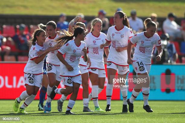 Adelaide Players celebrate a goal during the round 11 WLeague match between the Newcastle Jets and Adelaide United at McDonald Jones Stadium on...