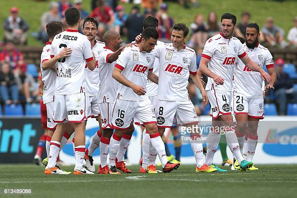 Adelaide players celebrate a goal during the round one ALeague match between the Newcastle Jets and Adelaide United at Hunter Stadium on October 9...
