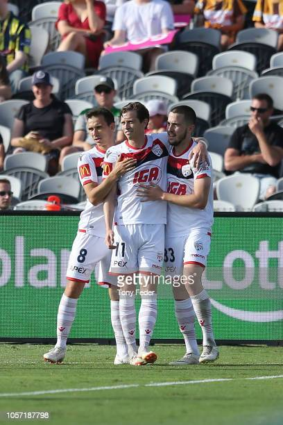 Adelaide players celebrate a goal during the round three A-League match between the Central Coast Mariners and Adelaide United at Central Coast...