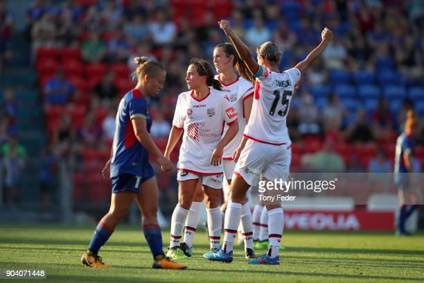 Adelaide players celebrate after the win over the Jets during the round 11 WLeague match between the Newcastle Jets and Adelaide United at McDonald...