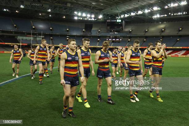 Adelaide Players celebrate their win during the round 20 AFL match between Adelaide Crows and Hawthorn Hawks at Marvel Stadium on July 24, 2021 in...