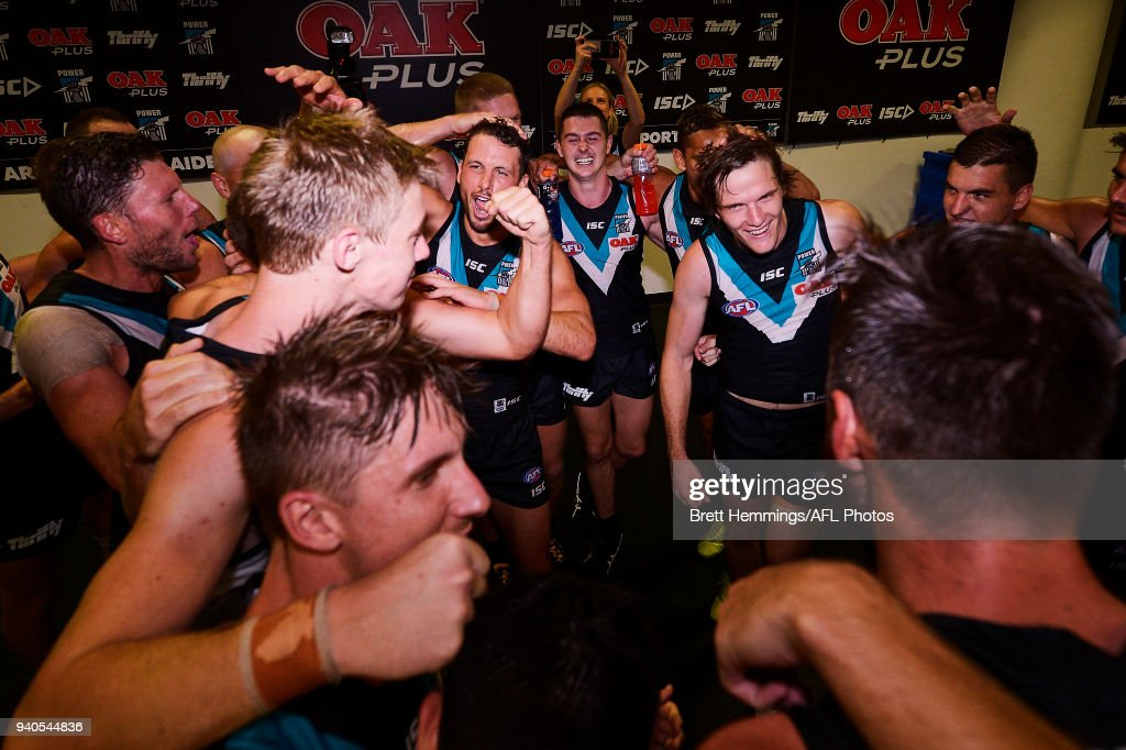 Adelaide players celebrate victory during the round two AFL match between the Sydney Swans and the Port Adelaide Power at the Sydney Cricket Ground on April 1, 2018 in Sydney, Australia.