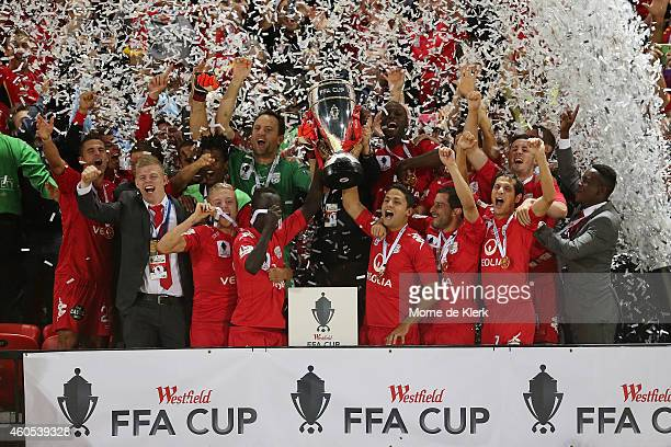 Adelaide players celebrate with the cup after winning the FFA Cup Final match between Adelaide United and Perth Glory at Coopers Stadium on December...