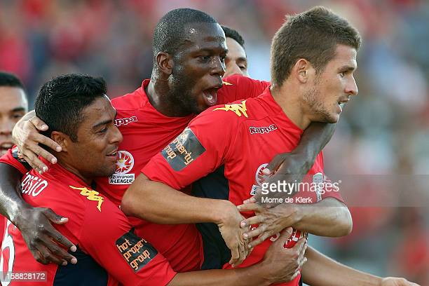 Adelaide players congratulate team mate Dario Vidosic after he scored a goal during the round 14 A-League match between Adelaide United and Sydney FC...