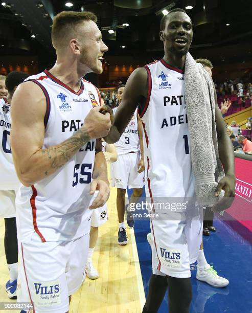 Adelaide players Mitch Creek and Majok Deng celebrate the win during the round 13 NBL match between the Brisbane Bullets and the Adelaide 36ers at...