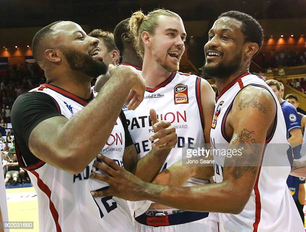 Adelaide players Shannon Shorter Caleb Davis and Ramone Moore celebrate the overtime win during the round 13 NBL match between the Brisbane Bullets...