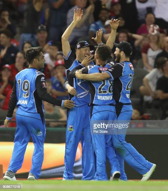 Adelaide Strikers Ben Laughlin and Jake Weatherald celebrate combining to catch Renegades Dwayne Bravo during the Big Bash League match between the...